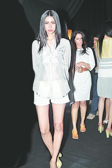 Anita Dongre checks the models while Sapna Kumar strikes a p