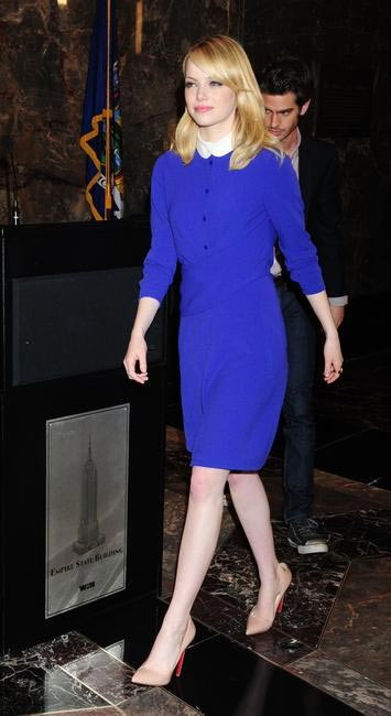 Emma Stone in a Carven dress and Christian Louboutin heels