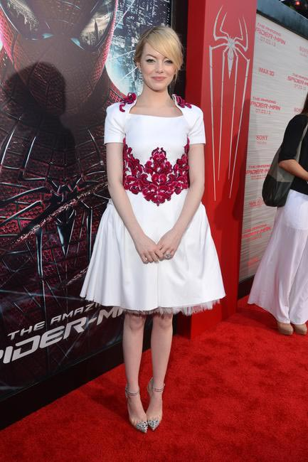 Emma Stone in a Chanel dress and Christian Louboutin shoes