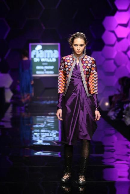 Asymmetrical draped dress over sheer leggings by Payal Pratap