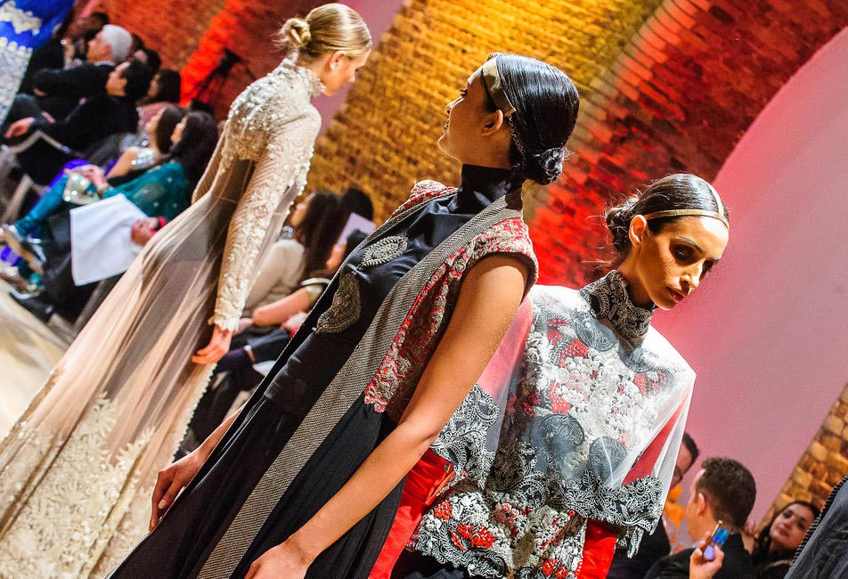 Models showcase Anamika Khanna's collection during the charity gala in London