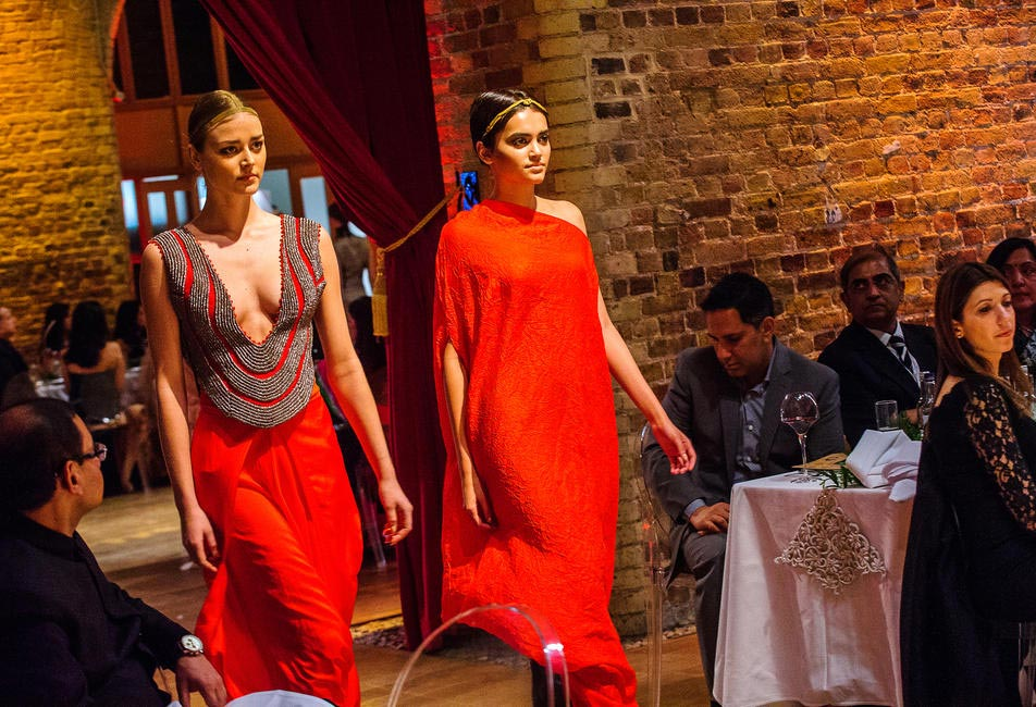 Models showcase Anamika Khanna's collection during the charity gala