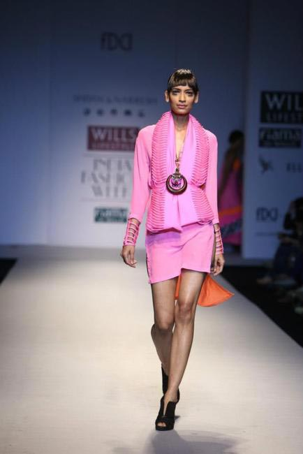 Shivan & Narresh's Autumn Winter collection inspired by Naïve illustrations used fun colours like pink, orange and blues
