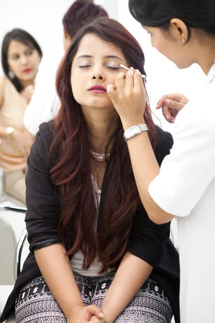 A guest trying Clinique make up