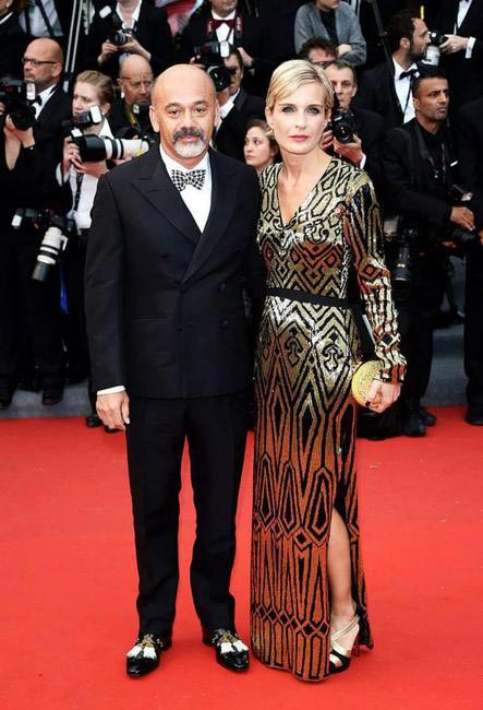 Christian Louboutin with Melita Toscan du Plantier in Abu Jani Sandeep Khosla gown and Louboutin shoes and clutch