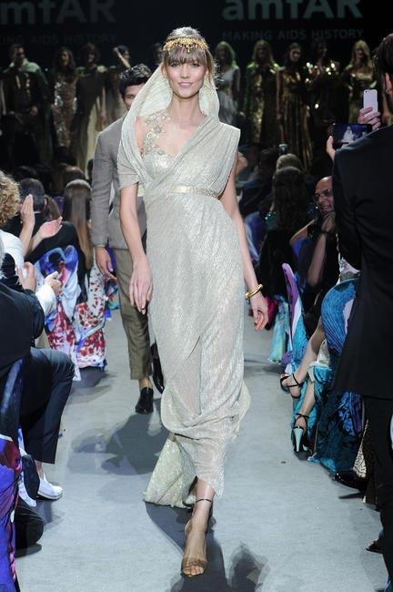 Karlie Kloss walked for Tarun Tahiliani at the amFAR fashion show 2013