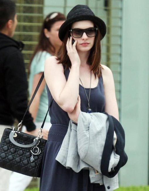 Anne Hathaway carrying Lady Dior