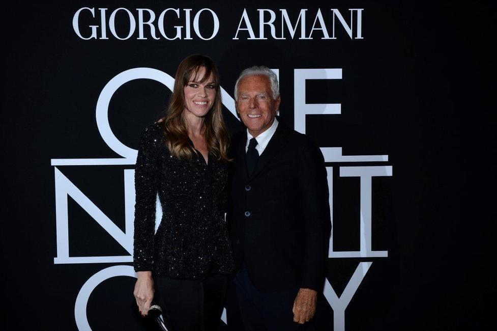 Mr. Armani and Hilary Swank