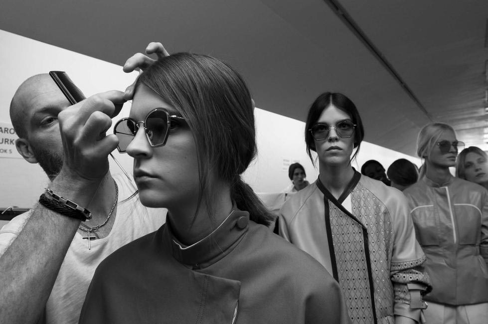 Angular sunglasses and been-out-all-day look at Tod's