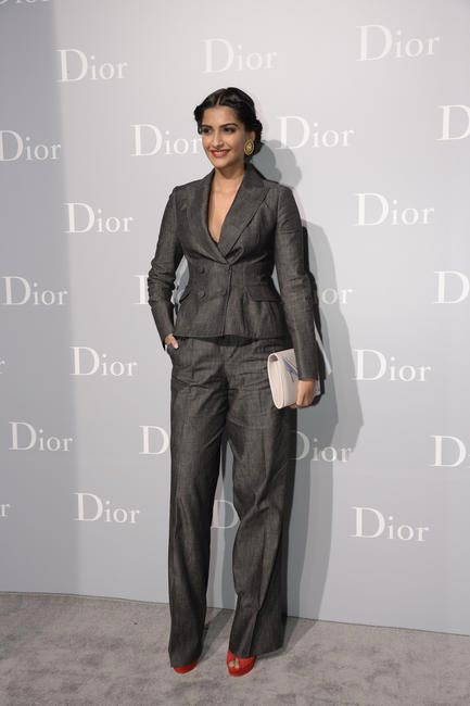 Sonam Kapoor wore a charcoal Denim bar suit with a limited edition Andy Warhol clutch, both by Dior