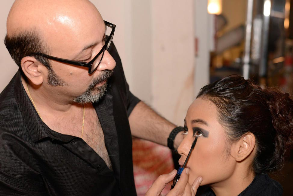 MICKEY CONTRACTOR WORKING BACK STAGE ON A MODEL