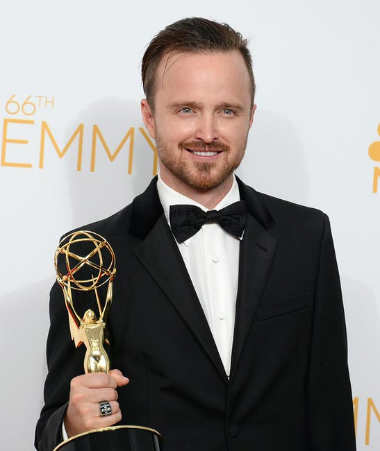 Aaron Paul poses in the press room with the award for outstanding supporting actor in a drama series for his work on Breaking Bad