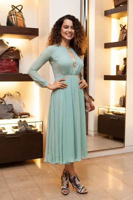 Dressed in Burberry and her signature curls, Kangana Ranaut looked stunning