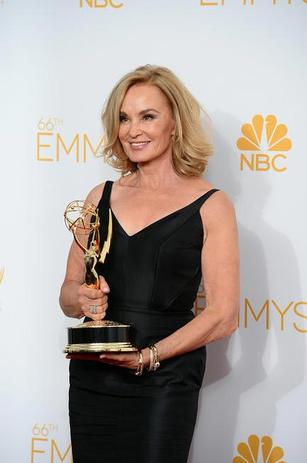 Jessica Lange poses with the award for outstanding lead actress in a miniseries or a movie for her work on �??American Horror Story Coven in the pre...