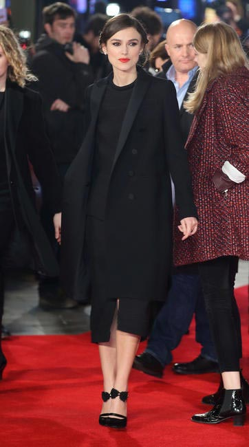Keira Knightley teamed up a Gucci coat with a Proenza Schouler midi dress