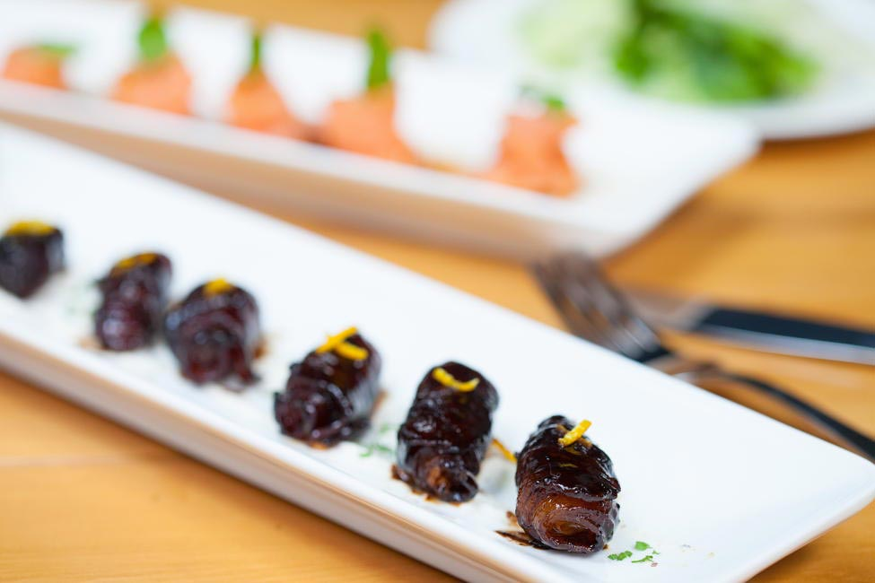 Bacon and parmesan wrapped dates with creme fraiche is the perfect appaetizer to go with your cocktails