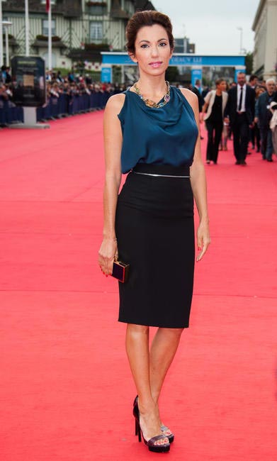 DATE NIGHT -French Actress Aure Atika adds glamour to her pencil skirt with a silk blouse and statement baubles