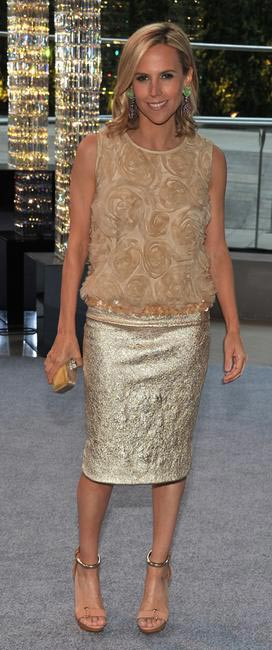 DRESSY -Tory burch wears a dressy top with a gold accentuated pencil skirt