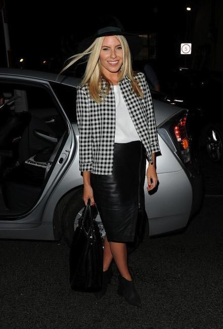 SPUNK - Mollie Kings goes spunk with a houndstooth jacket and leather skirt finshing the look with ankle boots