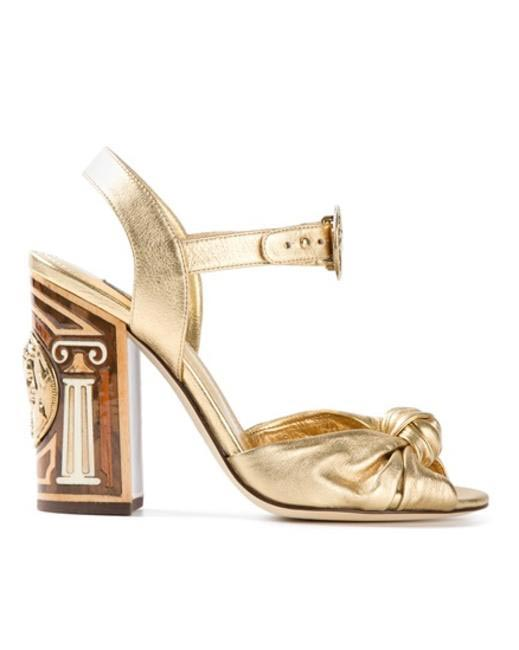 DOLCE & GABBANA ancient coin detailed sandals via farfetch.com