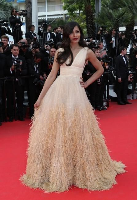 Freida Pinto in Michael Kors at the premiere of 'Saint Laurent' Photo courtesy -  L'Oreal Paris