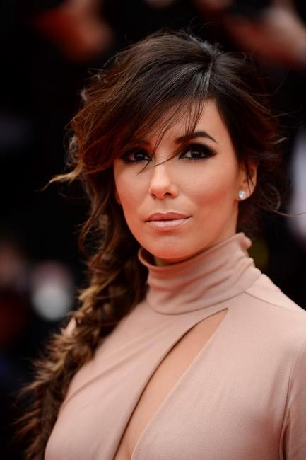Messy braid, nude lips and super dark eyes make Eva Longoria look smoking hot. Make-up by L'Oreal Paris at Cannesjpg