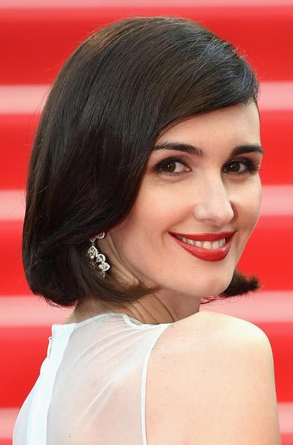 Red is Hollywood's most preferred colour and Paz Vega works it just fine. Make up by Dior at Cannes 2014