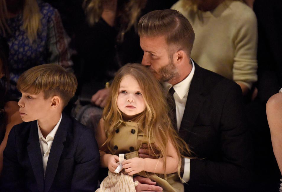 David, Romeo and Harper Beckham on the front row at the Burberry London In Los Angeles event