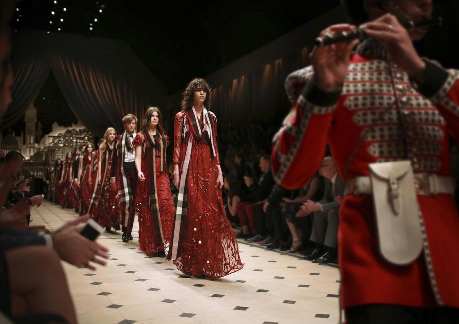 Models walk to the tunes of a live band