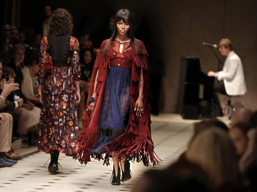Naomi Campbell walks the ramp for Burberry