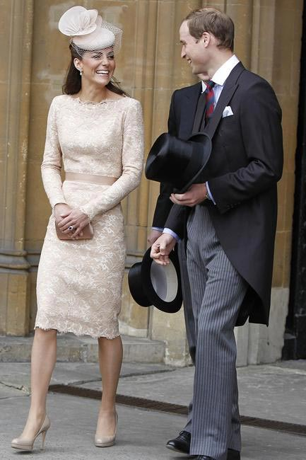 A dainty cream lace pencil dress by Alexander McQueen and a hat by Jane Taylor for to mark the Queen's Diamond Jubilee