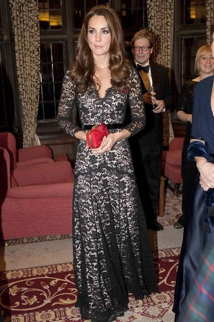 A lace overlay gown by Temperley London, worn with a Red bow clutch and Gemstone embellished Poppy