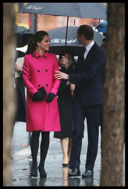 At the 9_11 memorial during her visit to states in a striking Fuschia Mulberry coat