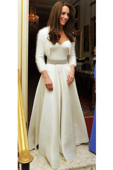 In Alexander McQueen for her wedding reception at the Buckingham Palace