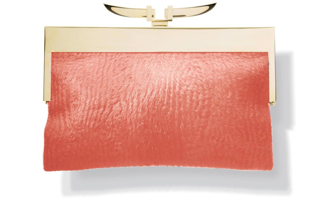Add a pop to any outfit with this Tangerine clutch by Jalan Sahba!