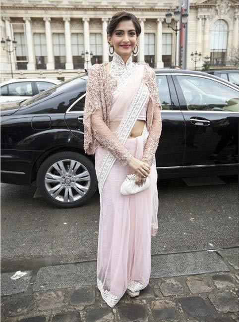 Sonam never fails to get those head turns, we love her way of styling and here she looks stunning wearing a peach net saree & a white halter neck bl...