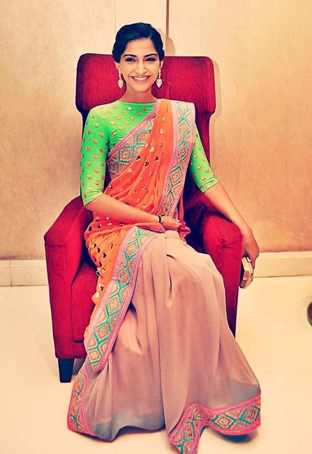 Sonam playing around with colors, wearing a Manish Arora saree. Gold embroidered work on the pallu, along with a contrast green embroided quarter sl...