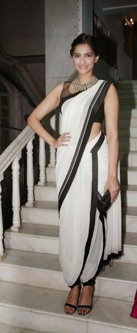 Tarun Tahiliani saree worn in a dhoti style. A white and black combo never goes out of style. make sure u pick a tall and slender pair of heels to c...