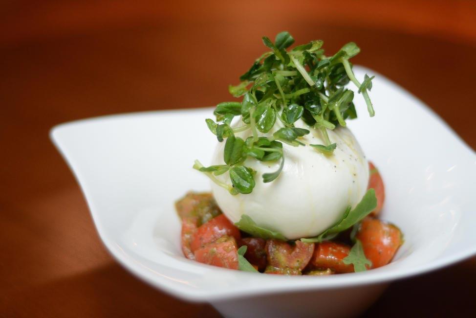 The Burrata - Home style creamy buffalo burrata cheese, heirloom tomato, with sweet basil pesto