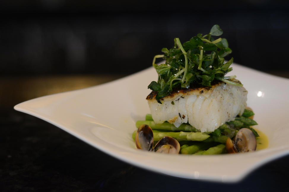 The Spigola - Parchment sea bass, wild asparagus, clams withlemon sauce