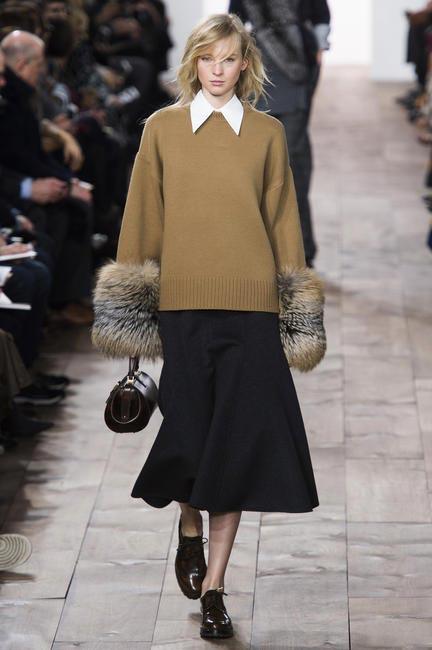 Model wearing a Michael Kors midi skirt