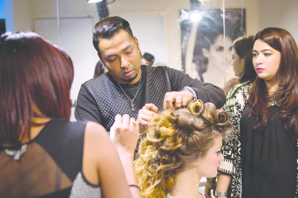 Shailesh Moolya, National Creative Director, Hair at Lakme Salon working on a model