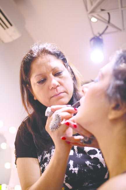 Sushma Khan, National Creative Director, Makeup at Lakme Salon working on a model