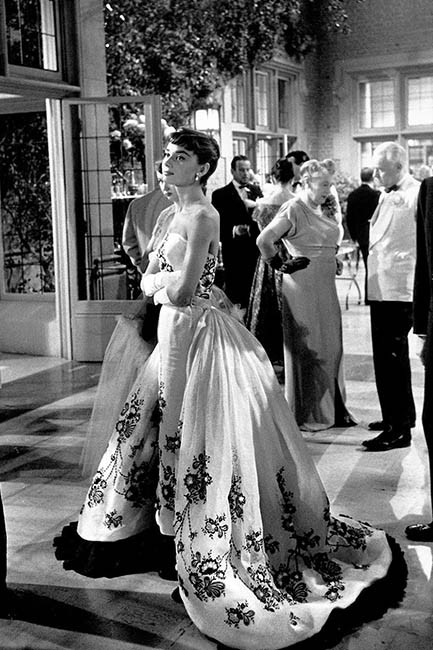 Audrey Hepburn wears a Givenchy gown in Sabrina