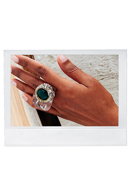 A lucite ring with rhinestones from Alexis Bittar
