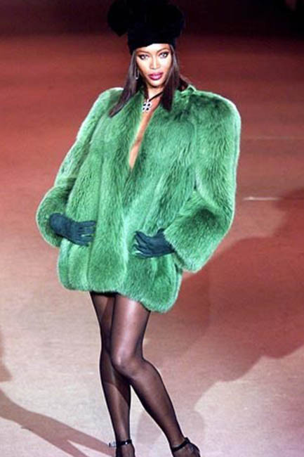 Naomi Campbell wears a vintage YSL coat from his Scandal collection from 1971