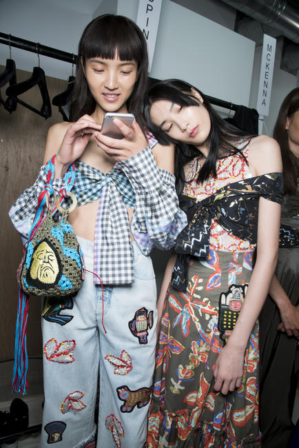 Models share a cozy moment backstage: Pilotto SS17